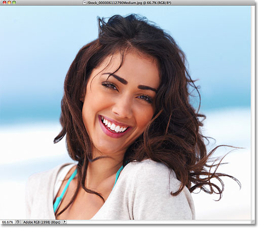 A photo of a woman smiling. Image © 2011 Photoshop Essentials.com.