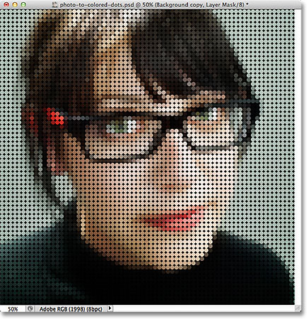 The image after filling the layer mask with the circle pattern. Image © 2011 Photoshop Essentials.