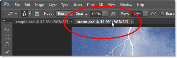 Switching between open photos by clicking on the tabs in Photoshop CS6. Image © 2013 Photoshop Essentials.com