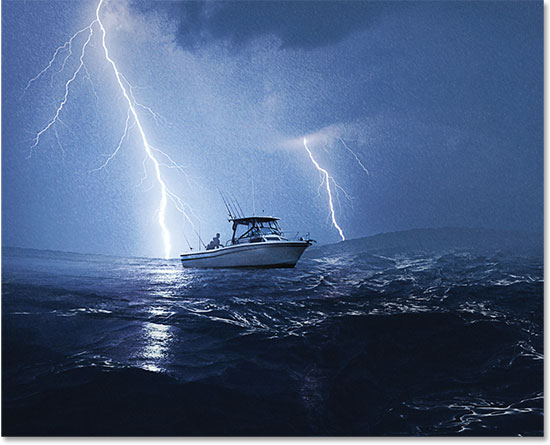 Boat in lightning storm. Image licensed from iStockPhoto by Photoshop Essentials.com