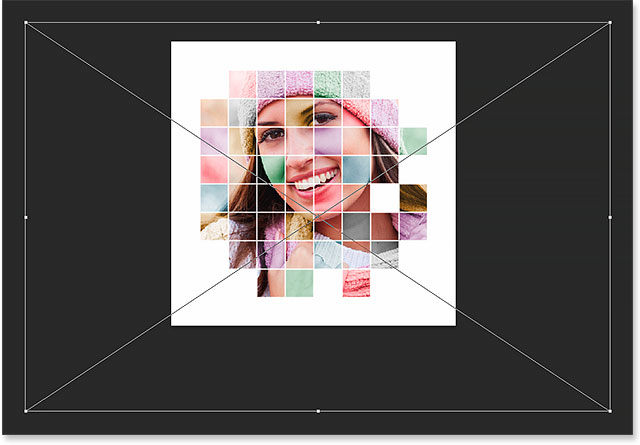 Re-adjusting the size and position of the photo inside the grid.