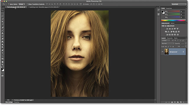 Making the portrait-oriented photo active by clicking its name tab.