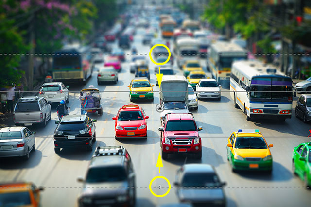 Resizing the transition areas for the Tilt-Shift blur effect. Image © 2012 Photoshop Essentials.com