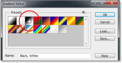 Selecting the Black, White gradient from the Gradient Editor in Photoshop. Image © 2013 Photoshop Essentials.com