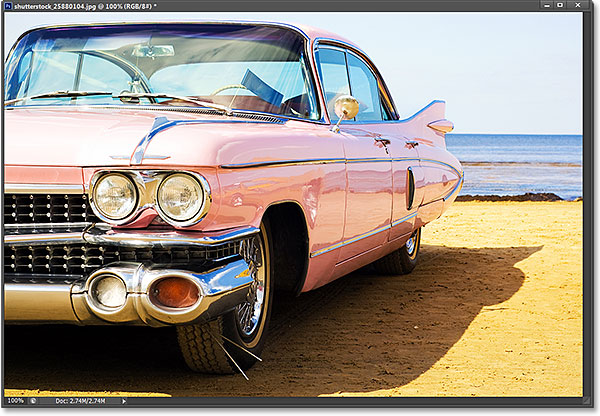 Classic pink car at beach. Photo licensed from Shutterstock by Photoshop Essentials.com