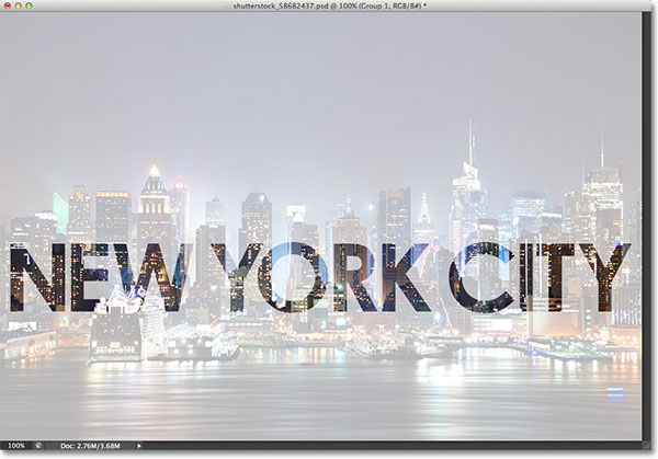 The photo on the Background layer is now visible through the shapes of the letters. Image © 2013 Photoshop Essentials.com.