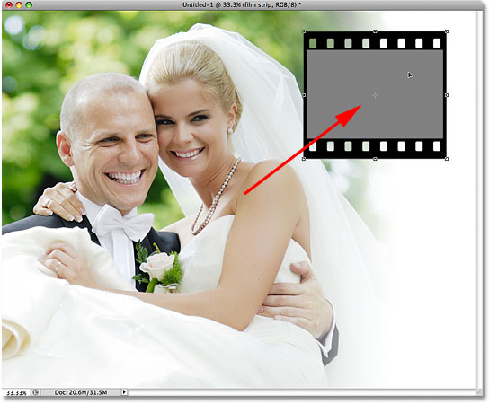 Moving the film strip with the Free Transform command in Photoshop. Image © 2009 Photoshop Essentials.com.