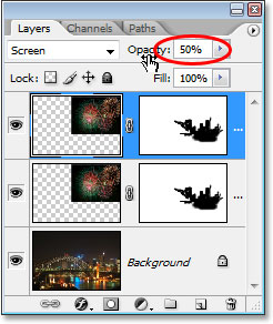 Lowering the opacity of the duplicate layer.