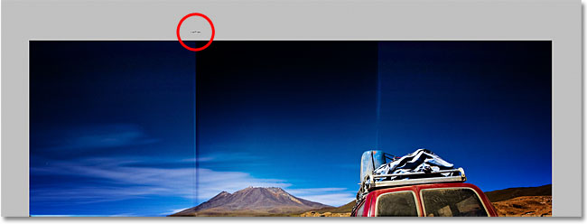 Click with the brush directly above the first vertical fold line. Image © 2011 Photoshop Essentials.com.