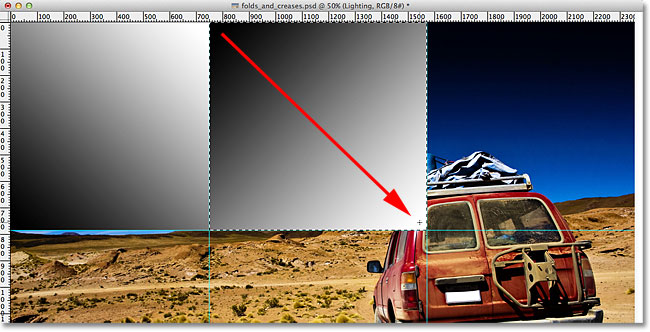 Drawing a second black to white gradient in the document. Image © 2011 Photoshop Essentials.com