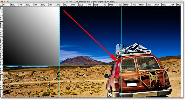 Drawing a selection outline around the top center section of the image. Image © 2011 Photoshop Essentials.com