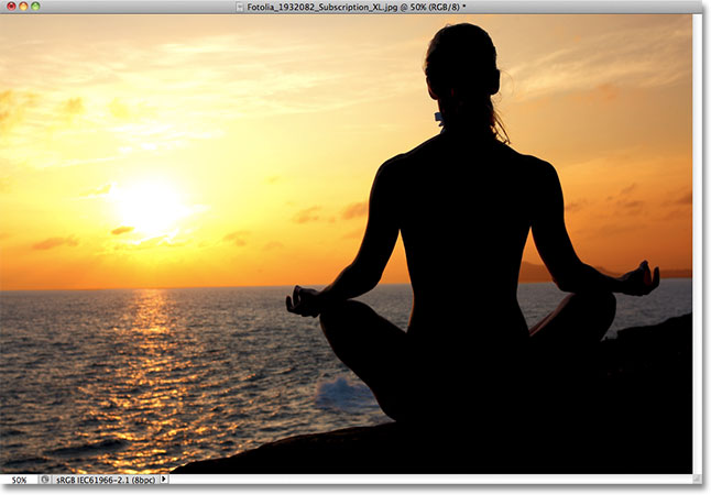 A woman meditating at sunset. Image licensed from Fotolia by Photoshop Essentials.com.