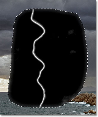 Most of the gray areas around the lightning bolt have been darkened to black. Image © 2011 Photoshop Essentials.com.