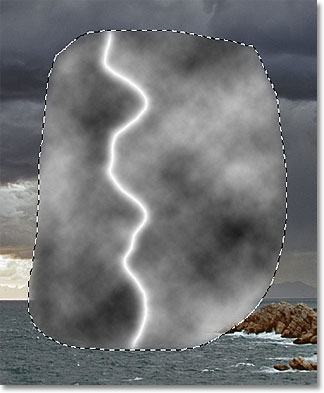 The lightning bolt now appears white. Image © 2011 Photoshop Essentials.com.