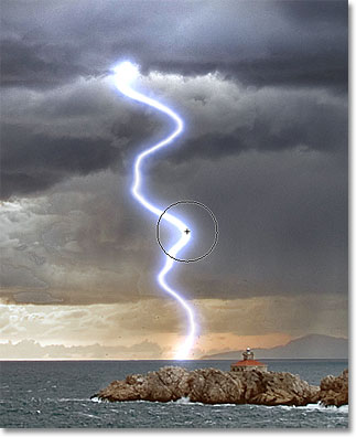 Adding highlights to the lightning bolt with the Dodge Tool. Image © 2011 Photoshop Essentials.com.