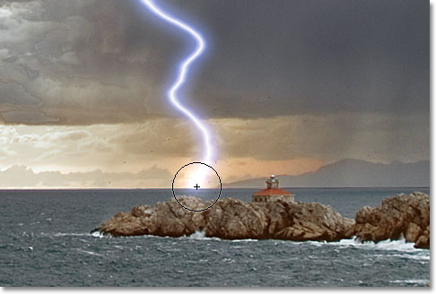Adding a highlight to the lightning strike with the Dodge Tool. Image © 2011 Photoshop Essentials.com.