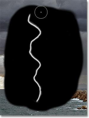 Painting with black over the transparent edges. Image © 2011 Photoshop Essentials.com.