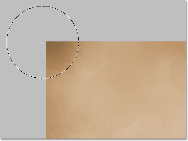 Darkening the paper edges with the Burn Tool in Photoshop.