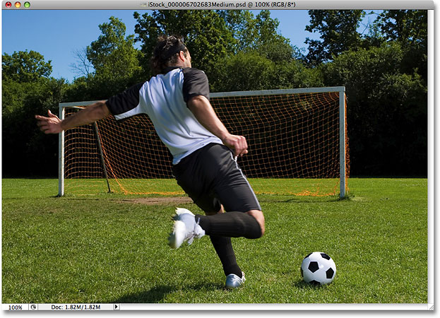 A photo of a soccer player about to kick the ball into the net. Image licensed from iStockphoto by Photoshop Essentials.com.