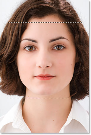 Drag out a square selection around the person's face.
