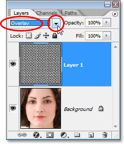 Changing the blend mode of the pattern layer to 'Overlay'.