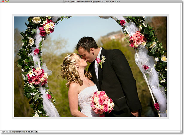 The image after adding a border with a Stroke layer style. Image © 2010 Photoshop Essentials.com.