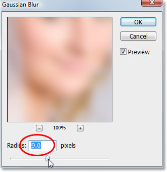 Applying the Gaussian Blur filter to the bottom layer in Photoshop.