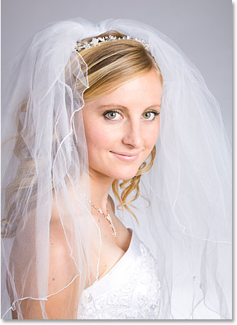 A photo of a young bride smiling.