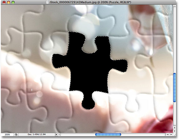 The image after deleting the second puzzle piece. Image © 2008 Photoshop Essentials.com.