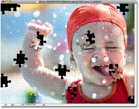 More puzzle pieces have been removed from the photo. Image © 2008 Photoshop Essentials.com.