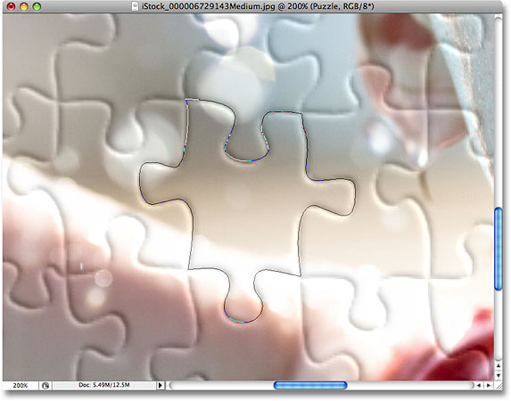 Drawing a path around another puzzle piece. Image © 2008 Photoshop Essentials.com.