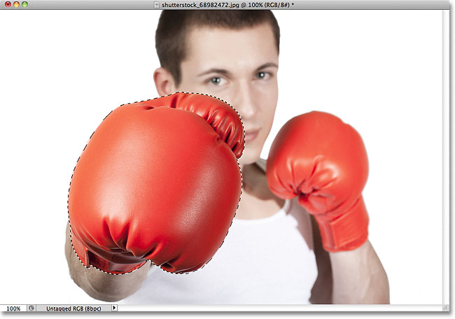 The boxing glove in the photo has been selected. Image © 2011 Photoshop Essentials.com.