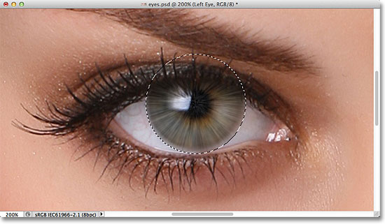 The image after applying the Radial Blur filter to the eye. Image © 2011 Photoshop Essentials.com.