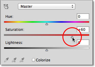 Dragging the Saturation slider for the Hue/Saturation adjustment layer.
