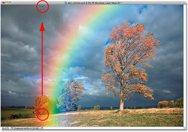 Dragging a black-to-white gradient from the base of the rainbow to the top of the image.