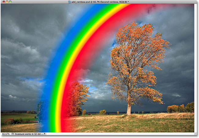 A reverse color rainbow gradient has ben added to the photo. Image © 2010 Photoshop Essentials.com
