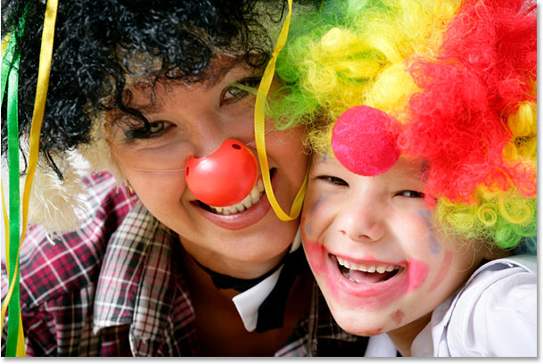 A photo of a mother and son dresses as clowns.