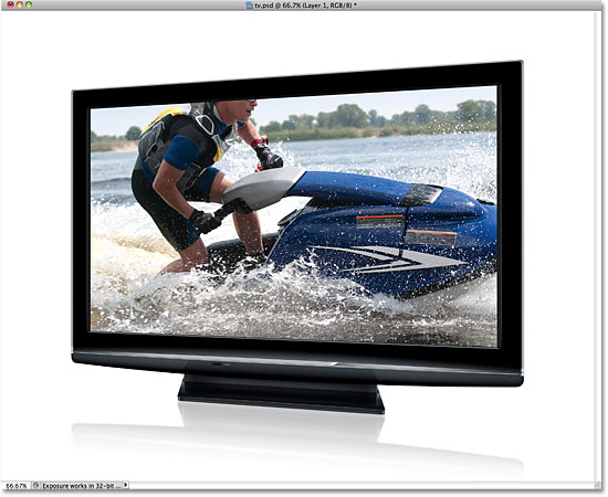 The second photo now appears on the tv screen. Image © 2010 Photoshop Essentials.com