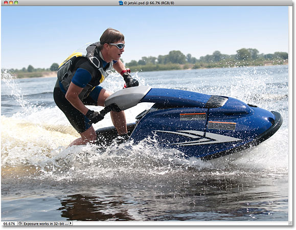 A jetski racing on the water. Image licensed from iStockphoto by Photoshop Essentials.com.