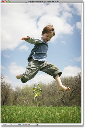 A young boy jumping outdoors. Image licensed from iStockphoto.com by Photoshop Essentials.com.