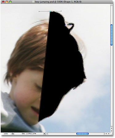 Drawing an outline around the boy with the Pen Tool. Image © 2008 Photoshop Essentials.com.