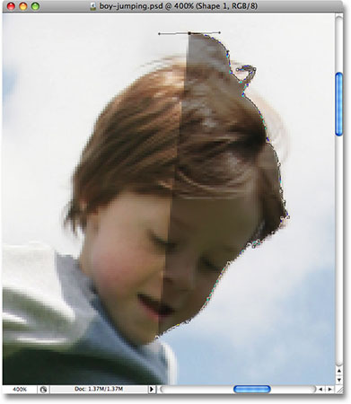 The opacity of the Shape layer is now lowered. Image © 2008 Photoshop Essentials.com.