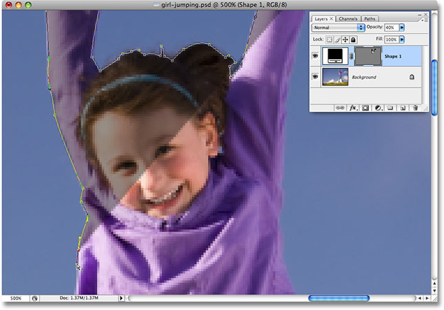 Drawing a shape outline around the girl with the Pen Tool. Image licensed from iStockphoto.com by Photoshop Essentials.com.