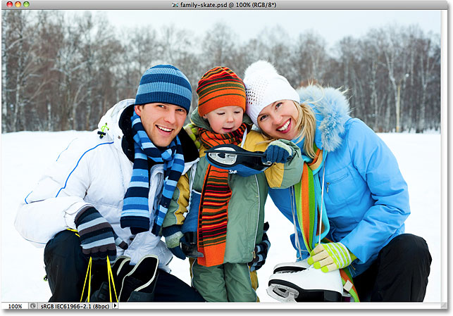 A family with ice skates smiling. Image licensed from Shutterstock by Photoshop Essentials.com.