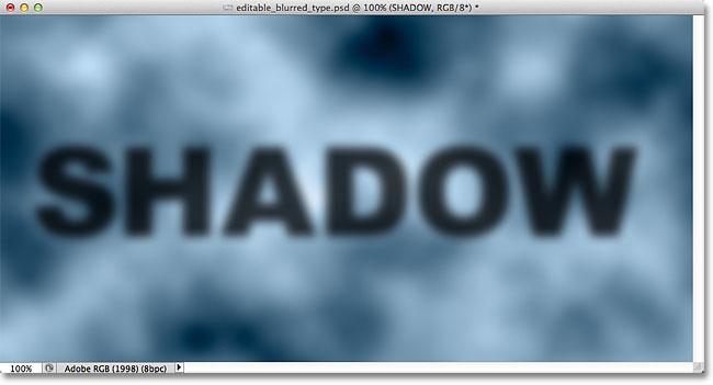 Teks bayangan kabur sekarang sepenuhnya terlihat. Image © 2012 Photoshop Essentials.com.