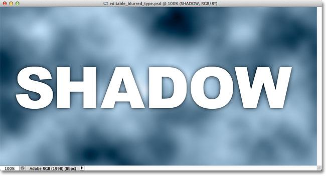 The drop shadow muncul di sekitar tepi huruf di jendela dokumen. Image © 2012 Photoshop Essentials.com.
