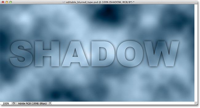 Gambar setelah menurunkan Opacity Isi teks. Image © 2012 Photoshop Essentials.com.