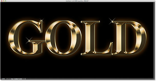 The gold text effect after adding some sparkles. Image © 2014 Photoshop Essentials.com