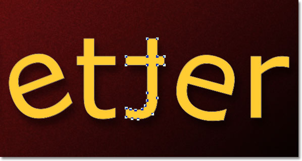 The letter in the word has been flipped horizontally. Image © 2011 Photoshop Essentials.com.