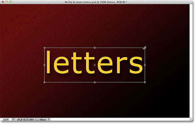Scaling text in Photoshop with the Free Transform command. Image © 2011 Photoshop Essentials.com.